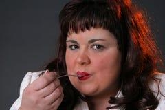 It´s good. Big girl eating cake stock photos