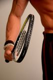 He's got himself a racquet. Male arm with racquetball racquet Stock Photography