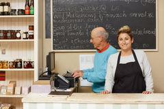 It's great having a family business. Two small business owners behind the deli counter Stock Photo