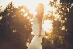 She`s growing and glowing. Happy pregnant woman spending time in nature. Copy space royalty free stock photos
