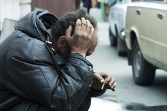 It's a hard life. The big problems of the homeless beggar Stock Photography