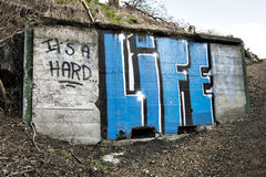 It's a Hard Life Graffiti on Concrete Wall Stock Photography