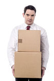 It's hard to carry this boxes Stock Photo