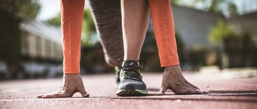 She`s on her mark. Woman preparing for a running. Close up royalty free stock images