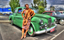 1950s Holden with woman in clothes of the time. Early 1950s green Holden sedan with woman in 1950s dress and fur royalty free stock images