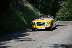 S.I.A.T.A. DAINA GS STABILIMENTI FARINA 1953 on an old racing car in rally Mille Miglia 2017. PESARO, ITALY - MAY 15: old racing car in rally Mille Miglia 2015 Royalty Free Stock Photography