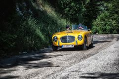 S.I.A.T.A. DAINA GS STABILIMENTI FARINA 1953 on an old racing car in rally Mille Miglia 2017. PESARO, ITALY - MAY 15: old racing car in rally Mille Miglia 2015 Royalty Free Stock Images