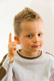 It's important!. Child pointing something important by his finger royalty free stock photo