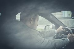 It*s important to get in time. Young business man driving car. Close up stock photos