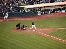 A's Kevin Kouzmanoff swings at an incoming pitch stock photography