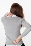 20s kobieta w tylnym widoku z kręgosłupa napięciem i obolałością Fotografia Royalty Free