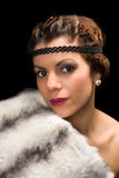 1920s lady with fur. Glamour style vintage 1920 actress posing like a diva stock photos