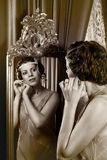 1920s lady in mirror Royalty Free Stock Photos