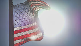 It`s Legendary. The American Flag blowing in the wind as the Sun lights the way Stock Photo