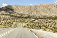 It`s a lonely road. A lonely road through the Nevada desert Stock Image
