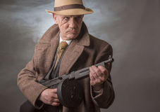 1940s male gangster holding a machine gun Royalty Free Stock Photo