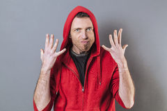 40s man expressing exasperation and impatience. Hand gesture concept - angry 40s man expressing exasperation and impatience with nervous hands up,studio shot Royalty Free Stock Photography