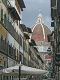 S.Maria del Fiore Cathedral. A view of Brunelleschi's dome of S.Maria del Fiore Cathedral in Florence, Italy, seen from a narrow traditional road Royalty Free Stock Photo