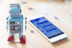 S?mbolo para o bot, o smartphone e o mensageiro do bate-papo foto de stock