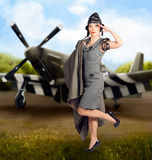 40s military pin up girl. Air force style. Artistic photo illustration of a beautiful asian pinup woman in 1940s military dress making a salute in front of an Royalty Free Stock Photography