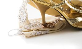 He's mine. Wedding rings on the heel of the wedding shoe (he's mine Stock Photos