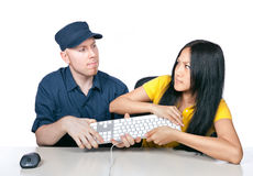 It's mine!. A young men and girl fighting for a keyboard Stock Images