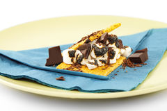 S'more on plate with chocolate and marshmellows Royalty Free Stock Images