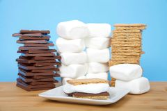 S`more on a plate with supplies stacked in background stock photography