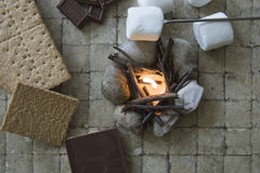 S`mores deconstructed with camp fire stock photography