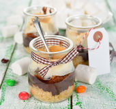 S'mores in a jar. American dessert s'mores in a jar on a white table Stock Photos