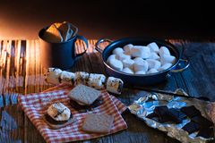 S`mores still life on a wooden table. stock photos