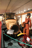 1900s motorcar next to woman in museum Royalty Free Stock Photography