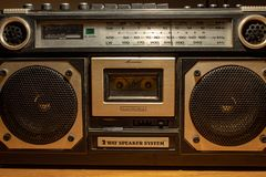 In the 70s and 80s the music was listened to through the cassettes, a magnetic storage device. The radios were very large. royalty free stock images