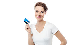 It's my new cash card !. Pretty smiling woman holding up credit card Stock Photo