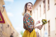 She`s a natural beauty in her element. Elegant woman on the street stock photography