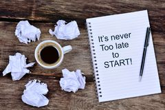 It`s never too late to start. Motivational quote. On notebook Stock Images