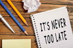 It's never too late. Words on notebook Stock Image