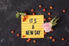 It`s a new day text in memo stock photo