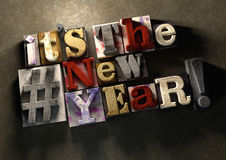 It's the new year! A title celebrating 2016 on wooden ink splatt. Ered printing blocks. Grungy typography on a concrete background. New year and the festive Royalty Free Stock Images
