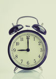 It`s nine o`clock already, time to wake up for breakfast, vintage old black metallic alarm clock Stock Image
