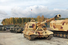 The 2S19. NIZHNY TAGIL, RUSSIA - SEP 26, 2013: The international exhibition of armament, military equipment and ammunition RUSSIA ARMS EXPO (RAE-2013). Russian Royalty Free Stock Images