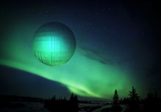 That's No Moon!. Science fiction image with a strange spherical object in the sky with green lights royalty free illustration