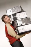 It's not so easy. Smiling man carrying three computers Royalty Free Stock Images