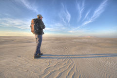 It's not too far. Desert hiking in the great salt lake dry lake beds - self portrait stock photo