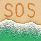 S.O.S. sign on the beach. Stock Image