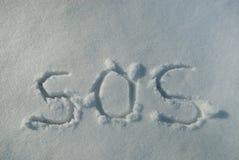 S.O.S. in Sneeuw Stock Afbeeldingen