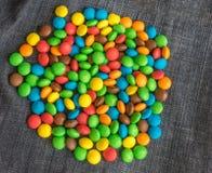 Słodcy Bonbons cukierki i cajg tekstura Zdjęcia Royalty Free