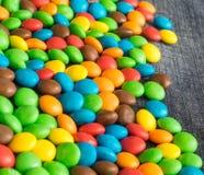 Słodcy Bonbons cukierki i cajg tekstura Fotografia Stock