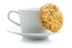 Słodcy pistacjowi ciastka i kawowy kubek Obraz Stock