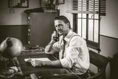 1950s office: director working on the phone Royalty Free Stock Photography